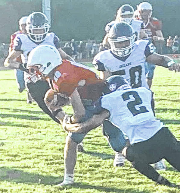 Elijah Chafin tackles Ridgedale's Ridge Barkley in the first quarter Friday night. The Indians won 49-14.