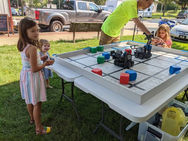 Selover Librarian Alan Wall demonstrates how to drive a robot at Downtown Days in Mount Gilead on Aug. 21. Visitors can once again drive robots during the Chesterville Heritage Day Festival on Sept. 11 in the Selover Library barn.