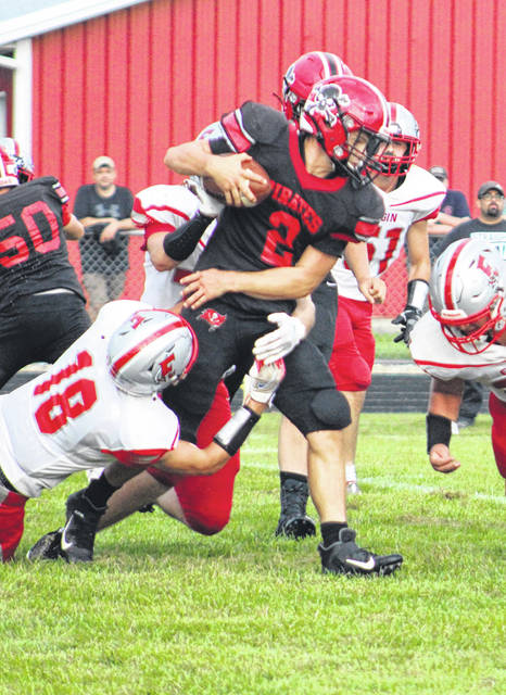 Ashton Plowman fights for yards against the Elgin offense on Friday in Cardington's win over the Comets.