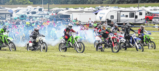 Motorcyclists start off their heat of the hare scrambles at Mid-Ohio Sports Car Course on Saturday, July 24.