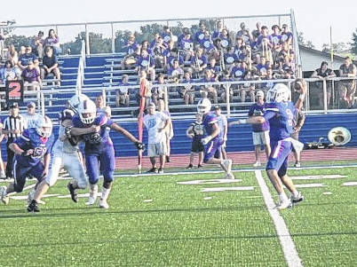 Highland quarterback Cooper Merckling was able to connect with Gavin Hankins on this pass attempt for a long touchdown in his team's Friday night season-opening game with Bloom-Carroll.