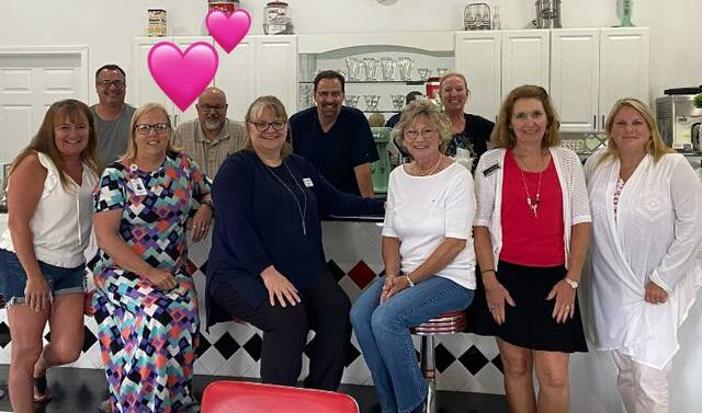 Club members had a lunch meeting at McChesney's Ice Cream Parlor in July. The club has made outreach into the county a priority.