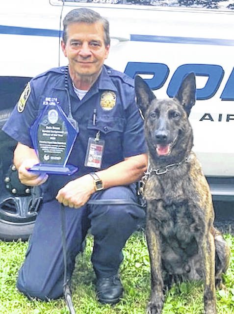 Dale Beam with his K-9 dog, Trex, a 4 and 1/2-year-old Dutch Shepherd.