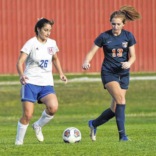 Highland's Emma Hinkle (26) controls the ball against Galion's Rilynn Keinath (13) during the Lady Scots' 8-1 win on Wednesday, Sept. 15, 2021. Hinkle scored two goals and assisted on five others for Highland.
