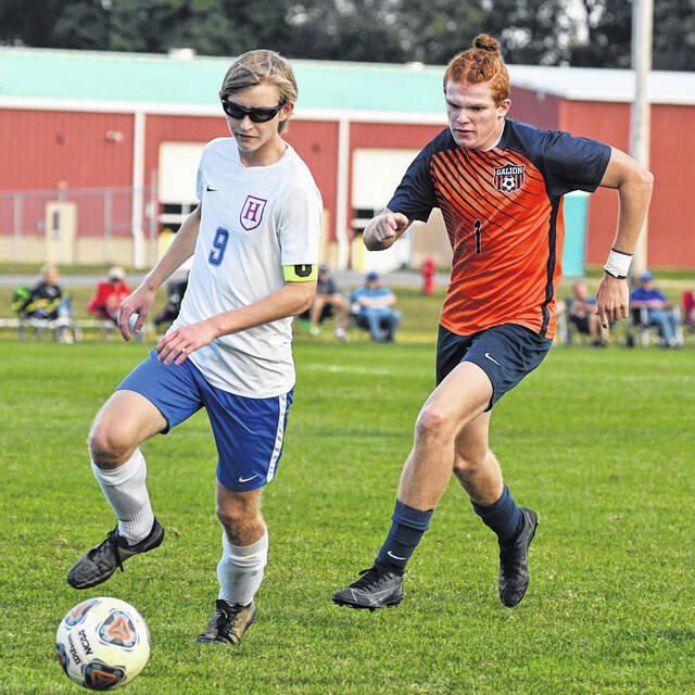 Highland's Jack Chaffee (9) dribbles past Galion's Brant Walker (1) during the Monday, Sept. 27, 2021, Mid Ohio Athletic Conference match between the Tigers and Scots. Galion prevailed 2-1 on a late goal by Kennan Walker with just five minutes to play in the match.