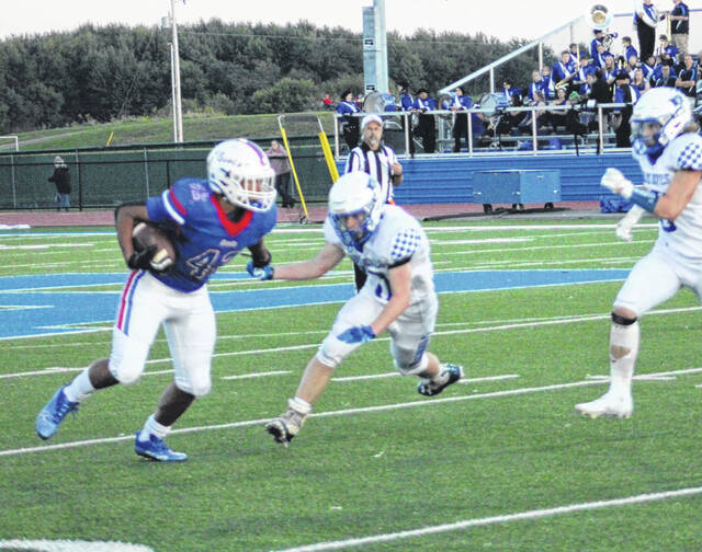 Highland's Dane Nauman ran past the Danville defense to the tune of 255 yards and four touchdowns, as the Scots tallied a 35-13 win over their Knox County rivals.
