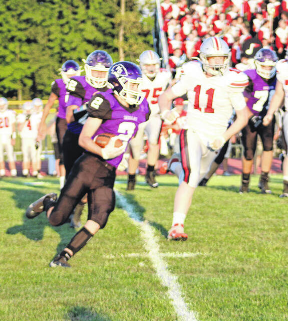 Elijah Chafin runs for yards in Mount Gilead's Friday night contest at home against Fredericktown.