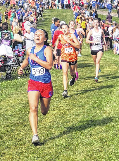 Highland's Jade Disbennett leads a group of runners to the finish line in Saturday's Highland Invitational.