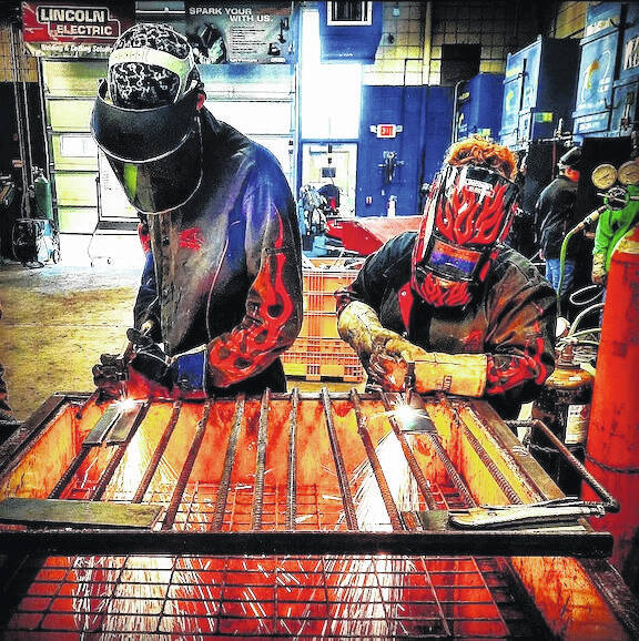 Students Trevor Brumfield and Emmalyn Long at work in the welding lab at Tri-Rivers Career Center.