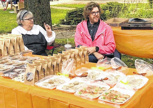 Connie Gandee came to Downtown Days Saturday to sell her homemade baked goods. Her son Josh and his wife Laura helped out on the square.