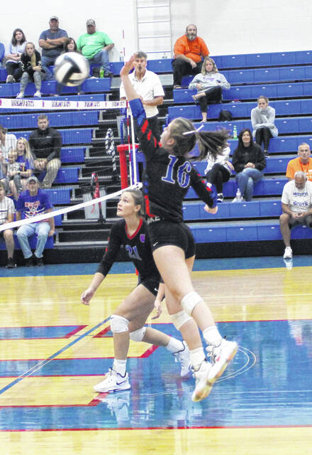 Highland senior Kyleigh Stiltner hits the ball in her team's three-set sweep of Clear Fork Tuesday that gave them a perfect 14-0 MOAC record for the 2021 season.