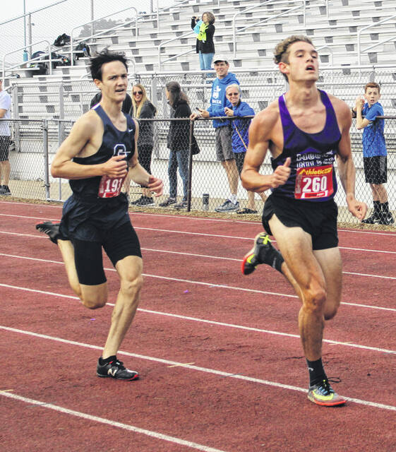Michael Snopik (r) won the boys' race on Saturday when Mount Gilead hosted a Division III showcase.