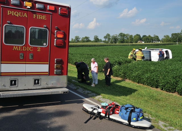 Mike Ullery | Daily Call Piqua fire department medics and Fletcher firefighters work at the scene of a crash on Piqua-Lockington Road on Tuesday.