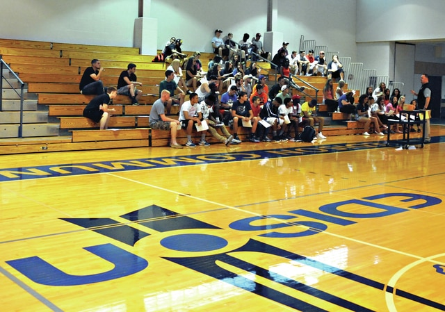 Mike Ullery | Daily Call Nate Cole, director of athletics at Edison Community College, addresses student athletes who will play for the Chargers during the upcoming school year during Student-Athlete Day at the school on Tuesday morning. A total of 80 student athletes have signed to play for the Chargers this year.