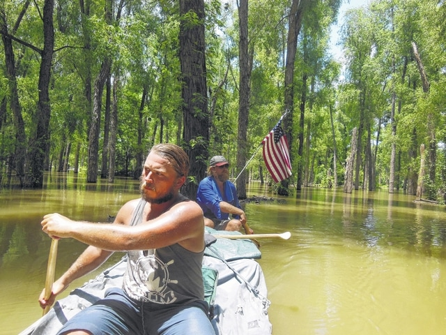 Alex Ross and Shea Selsor paddle down the Mississippi Delta bayou.