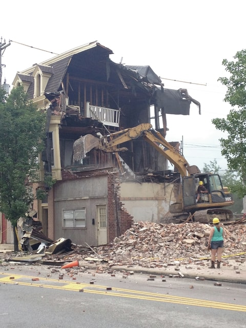 The building at 117 E. Water Street was demolished Monday afternoon after sitting vacant for a number of years. This demolition is part of the Downtown Riverfront Redevelopment Project in an effort to extend Lock 9 Park and make it a quality park.