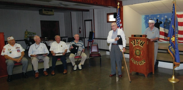 Emerson Shear, second from right, receives a plaque for 60 years continuous membership and service with Piqua VFW Post 4874 during a ceremony at the Post on Wednesday. The Post recognized five members for consecutive years of membership and service. Receiving plaques, in addition to Shear, a U.S. Army veteran, were Joe Goetz, U.S. Navy, 50 years; Flavil Pollock, U.S. Army, 50 years; Lewis Marrs, U.S. Army, 50 years; and, Rolland Wagner, U.S. Navy, 55 years. Serving as master of ceremonies for the event was Past Commander of VFW Post 4874, Dan Whitson.