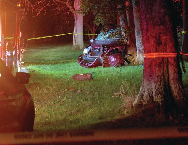 Mike Ullery | Daily Call A vehicle rests against a tree off Haskett Lane in Bethel Township following a crash that cost the driver his life early Friday morning.