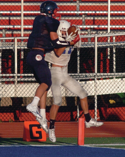 Mike Ullery | Daily Call Noah Lyman, 16, turns a would-be interception into a Piqua touchdown reception.