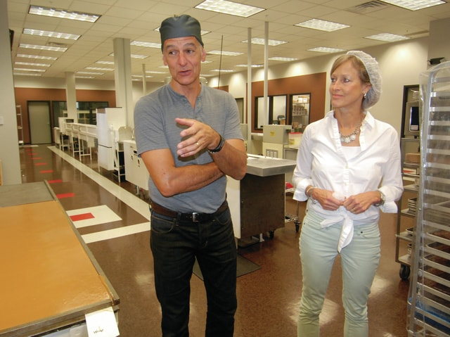 Mike Ullery | Daily Call Joe and Laurie Reiser, owners of Winan's Chocolates + Coffees give a tour of the new store and factory at 310 Spring St., the former <em>Piqua Daily Call</em> building, during Monday's grand opening.