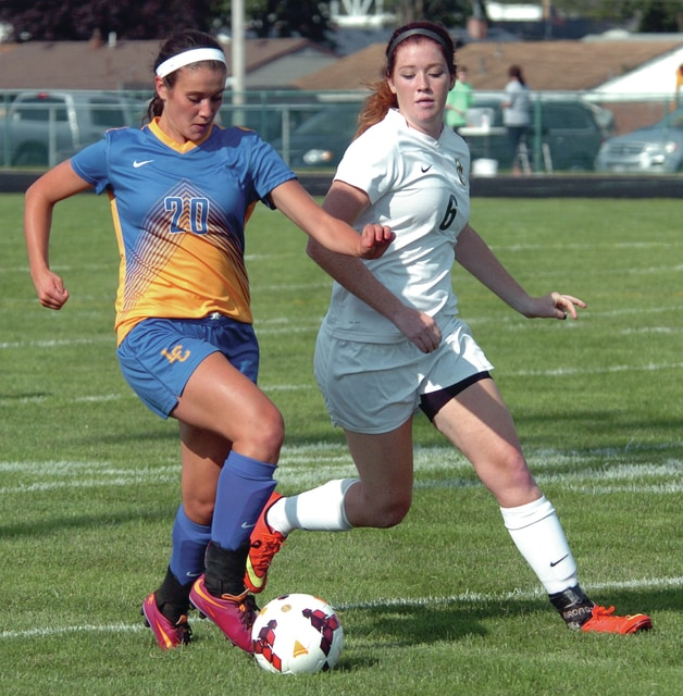 Mike Ullery/Daily Call Samantha Edwards dribbles the ball against Troy Christian's Hannah Benjamin.
