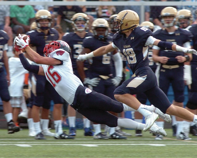 Mike Ullery | Daily Call Piqua's Noah Lyman, 16, lays out for a pass reception.