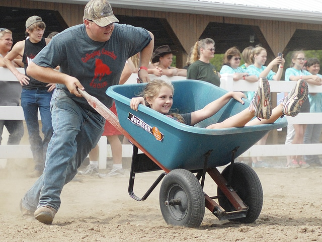 Anthony Weber | Troy Daily News Members of the Galloping Gauchos 4-H Club compete against other 4-H'ers during the Super Stars event at the Horse Arena Friday at the Miami County Fair.