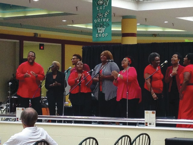 Second Baptist Church sings in the food court of the Miami Valley Centre Mall during the second day of the 2015 Church Fair on Saturday.