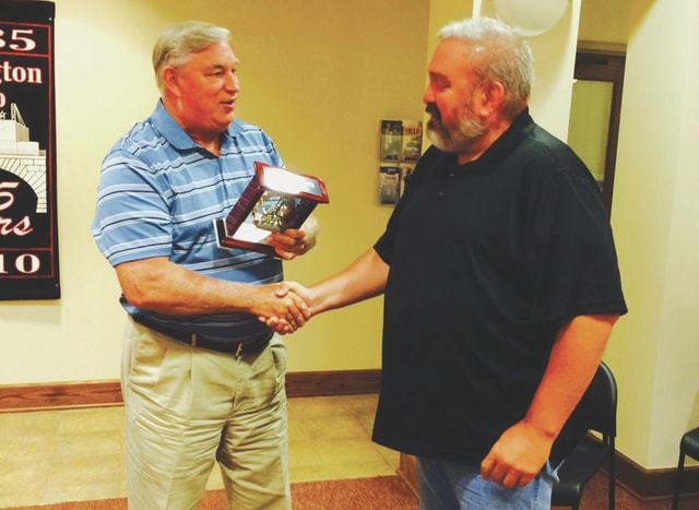 Courtesy photo Covington Mayor Ed McCord (left) shakes the hand of Sargeant Tim Demoss (right), who is retiring from the Covington Police Department after 19 years with the village.