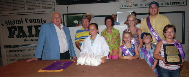 Howard Cheney purchased Abigail Kadel's Grand Champion Pen of Three rabbits for a record-breaking $3,000.
