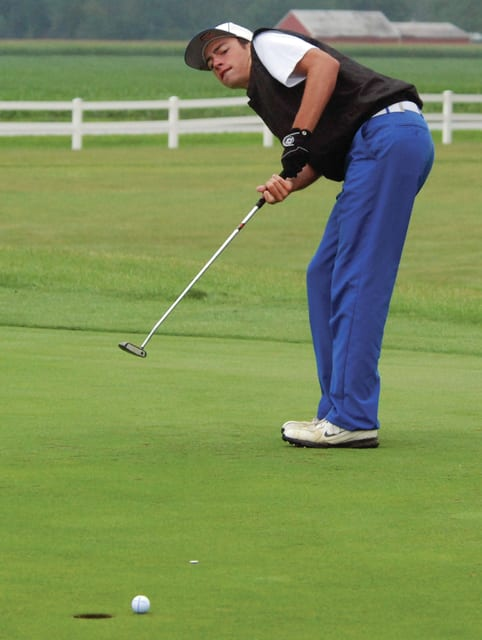 Mike Ullery/Daily Call Miami East's Scot Kirby uses some body English on the fourth green.
