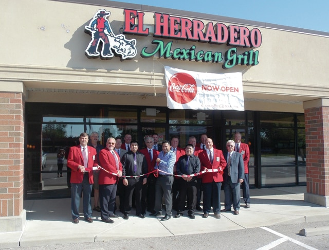 Courtesy photo Ambassadors from the Piqua Area Chamber of Commerce and city officials conducted a ribbon on Aug. 13, at El Herradero Mexican Grill, 1598 Covington Ave., Piqua. Cutting the ribbon is manager Carlos Cordoba, along with some of his staff.