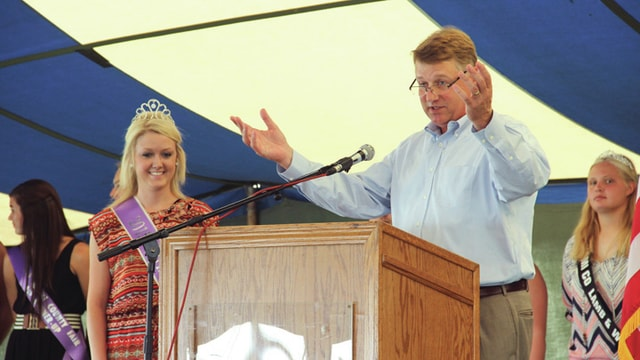 Miami County Commissioner John O'Brien, right, introduces the 2015 Fair Queen Brianna Ellish, left, during the Miami County Fair opening ceremony on Friday.