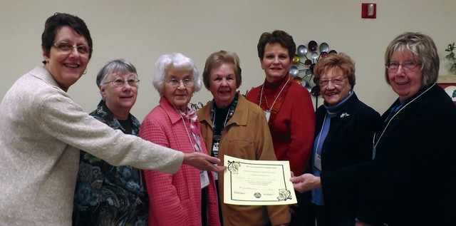 Provided photo Geri Rea, first vice president of OAGC, presents a 60-year award to members of the Piqua Green Leaf Garden Club, left to right, Geri Rea, Shauna Bushnell, Ruth Cameron, Karen McNeil, Betty Thompson, Alice Gordon, and Penny Ada.