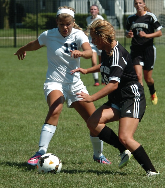 Mike Ullery | Daily Call Elizabeth Butt battles for possession Saturday for Piqua.