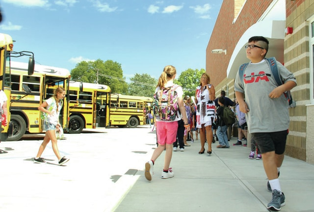 Students at Piqua Central Intermediate exit their new building for the first time on Monday after the first day of school.
