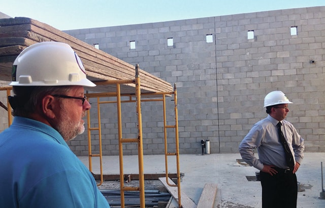 Project Manager Steve Miller, left, gives tour of the new PK-8 building as it stands to Covington Board of Education members on Thursday. Superintendent Gene Gooding, right, looks on at the progress.