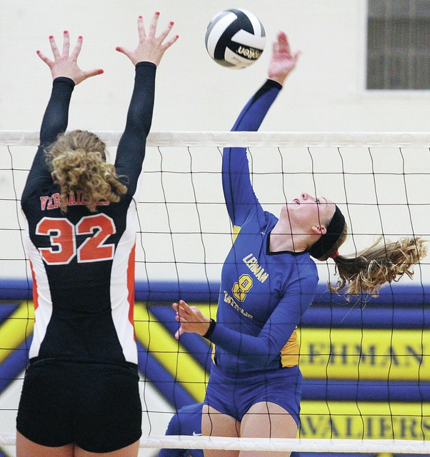 Lehman's #8 Sidney Chapman spikes the ball as Versailles' Christa Puthoff reaches up to defend at Lehman Tuesday, August 19.  Luke Gronneberg | Sidney Daily News