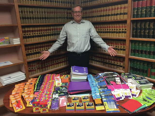 "Courtesy photo Mark Reedy displays some of the items that he has donated to ""Stuff the Bus"" with school supplies that will be donated to needy children."