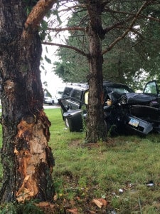 Contributed photo A vehicle rests against a tree following a Friday afternoon crash on St. Rt. 718