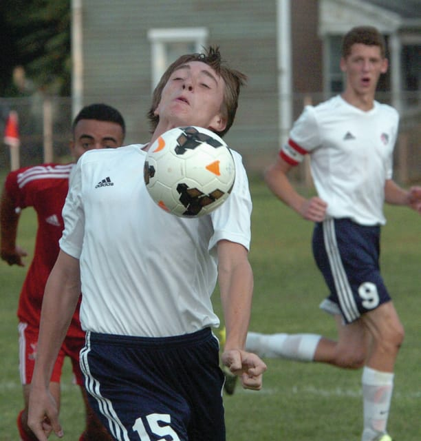 Mike Ullery | Daily Call Kyler Scherer, 15, uses his body to bring the ball down the field for the Indians.