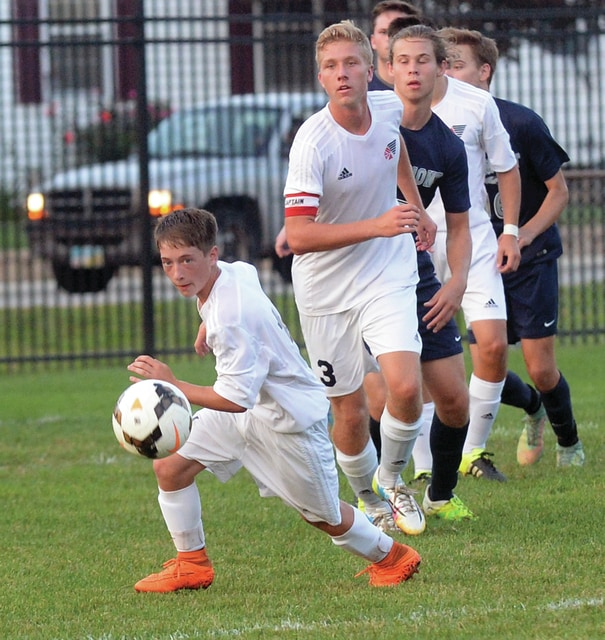 Mike Ullery | Daily Call Brandon Grissom, 14, chases down the ball as Bradley Hohlbein, 3, follows.