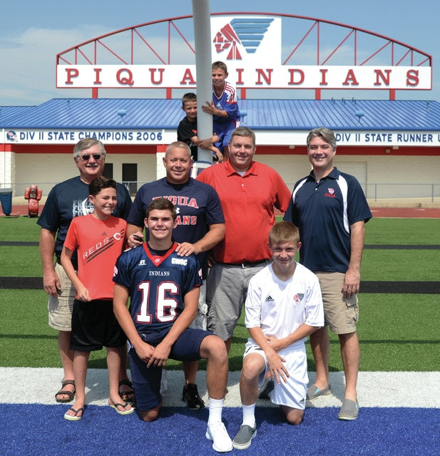 Mike Ullery | Daily Call The men of the Lyman family pose for a photo at Alexander Stadium/Purk Field on Saturday.