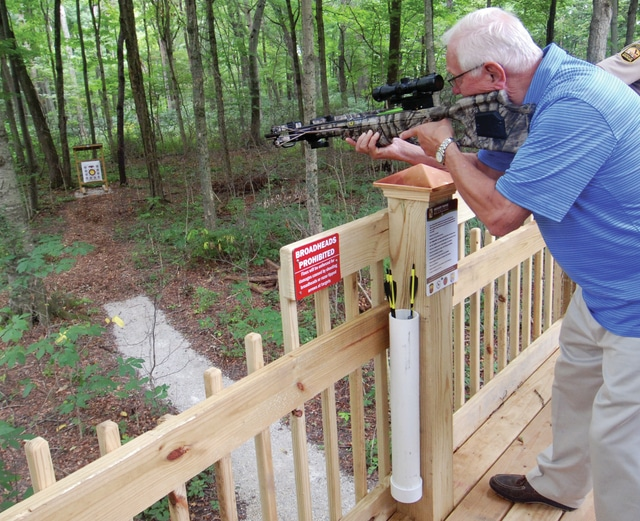 Mike Ullery | Daily Call Miami County Park District Board President John Wannemacher takes aim at a target on the newly opened archery range at Garbry Big Woods on Wednesday.