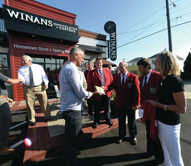 Mike Ullery | Daily Call Officials from the Piqua Area Chamber of Commerce present a membership plaque to Joe (left) and Laurie (far right) Reiser during a ribbon cutting ceremony at the new Winans Chocolate + Coffees on Thursday.