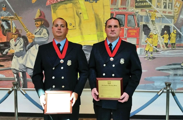 Contributed photo by Mike Rindler Piqua firefighters Josh Sullenberger, left, and Brad Weer were awarded the Ohio Fire Service Valor Award during ceremonies at the State Fire Academy in Columbus on Wednesday afternoon.
