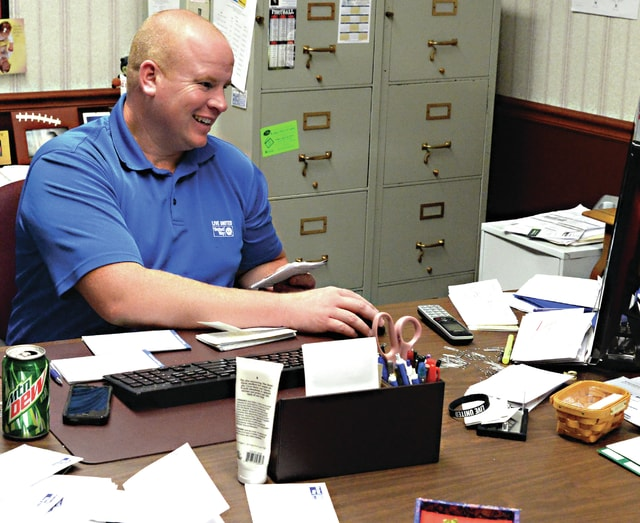 Mike Ullery | Daily Call Piqua United Way Executive Director, Sean Ford, enters donations into his computer at the United Way office on Tuesday. Ford said the 2015 campaign is closing in on $300,000, roughly 55% of, the $590,000 goal.