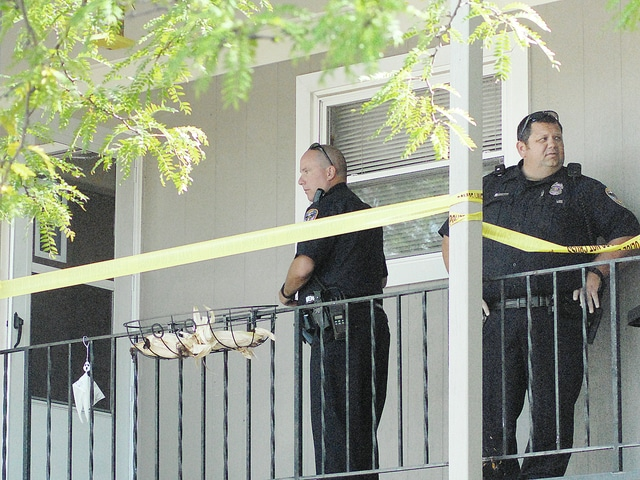 Anthony Weber | Troy Daily News Troy Police Department officers secure an area on the upper level of 1565 at McKaig Garden Apartments following a stabbing Wednesday shortly after 11 a.m.