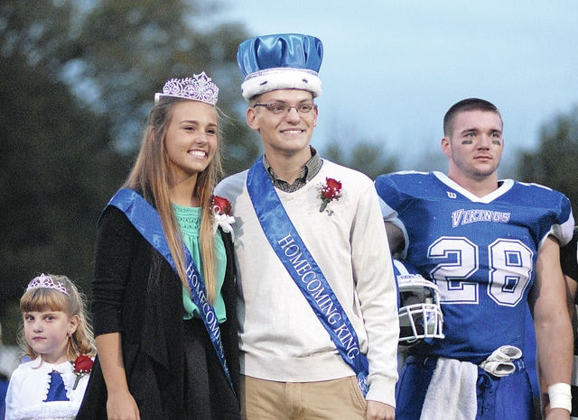 Anthony Weber | Troy Daily News Miami East High School crowned its 2015-16 Homecoming queen and king on Friday prior to the boys varsity football game against Mississinawa Valley. Lindsey Black was crowned queen, while Nathan Teeters was crowned king for Miami East. Last year's homecoming king, Colton McKinney, was on hand to assist in crowning East's royalty. A parade kicked off the homecoming festivities Friday evening and concluded with a dance Saturday night at the former high school.