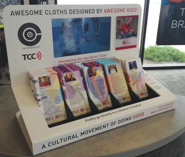 The display of screen-cleaning cloths on sale at The Cellular Connection (TCC) location in Piqua. The cloths, which feature artwork done by Riley Hospital youths, are on sale at TCC for $10, with 100 percent of the sales going back to Riley Hospital.